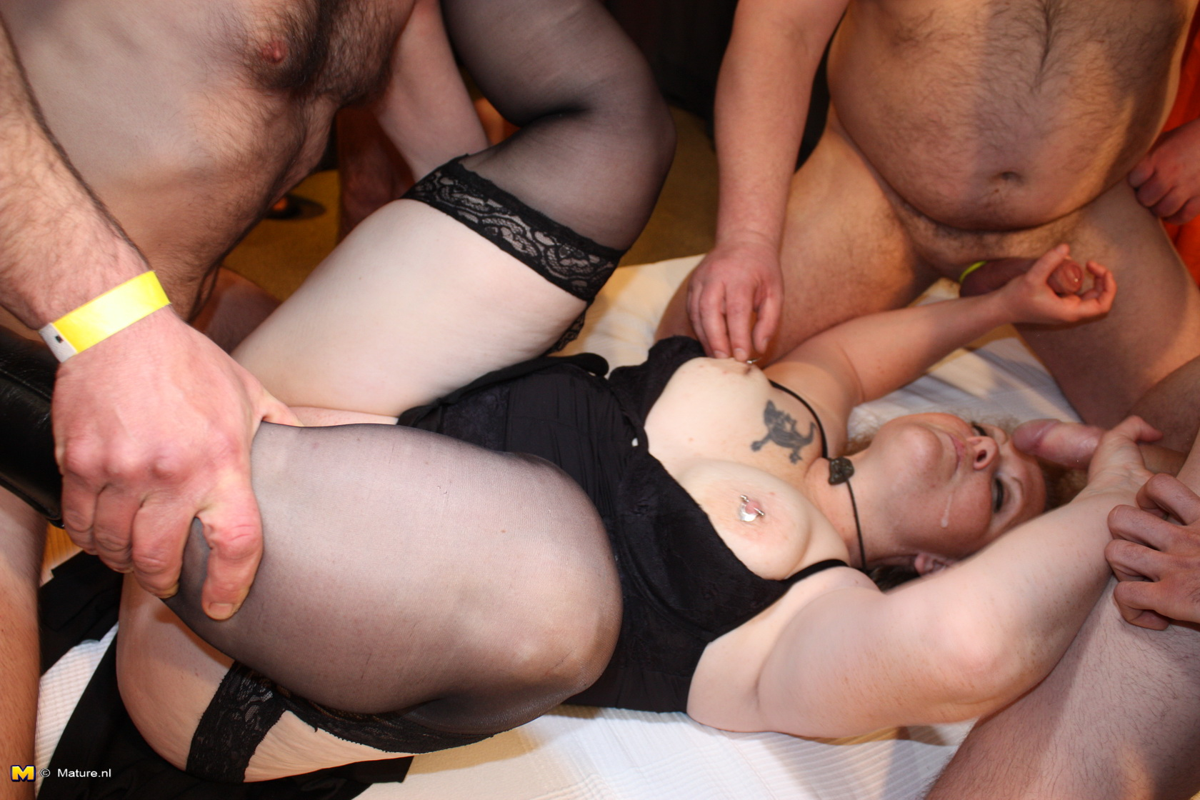 One horny BBW housewife blowing and boinking in a ganbang